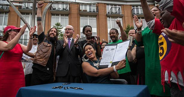 Mayor Bowser signs minimum wage bill